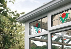 White uPVC conservatory with stained glass