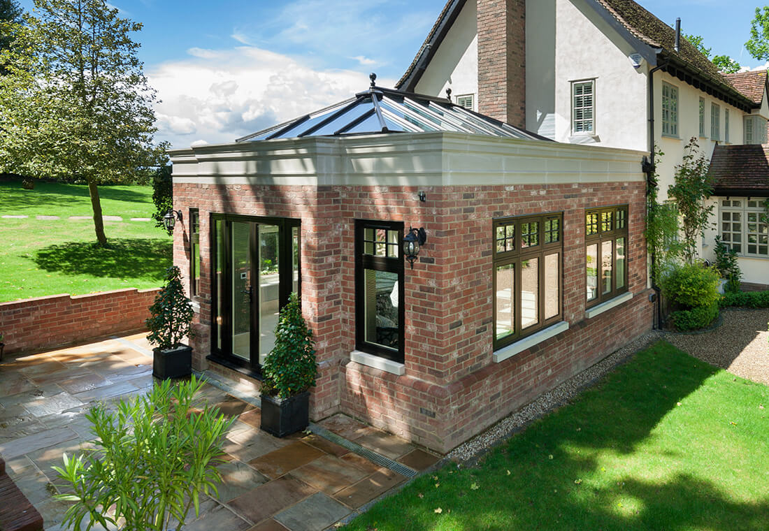 Red brick orangery with black Residence windows