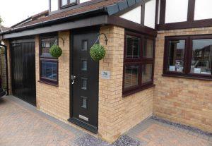 Black composite door and rosewood windows