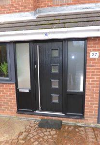 Black uPVC porch with a black Solidor composite door