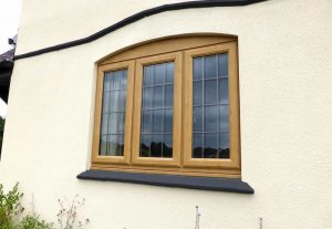 Irish oak effect casement window installation